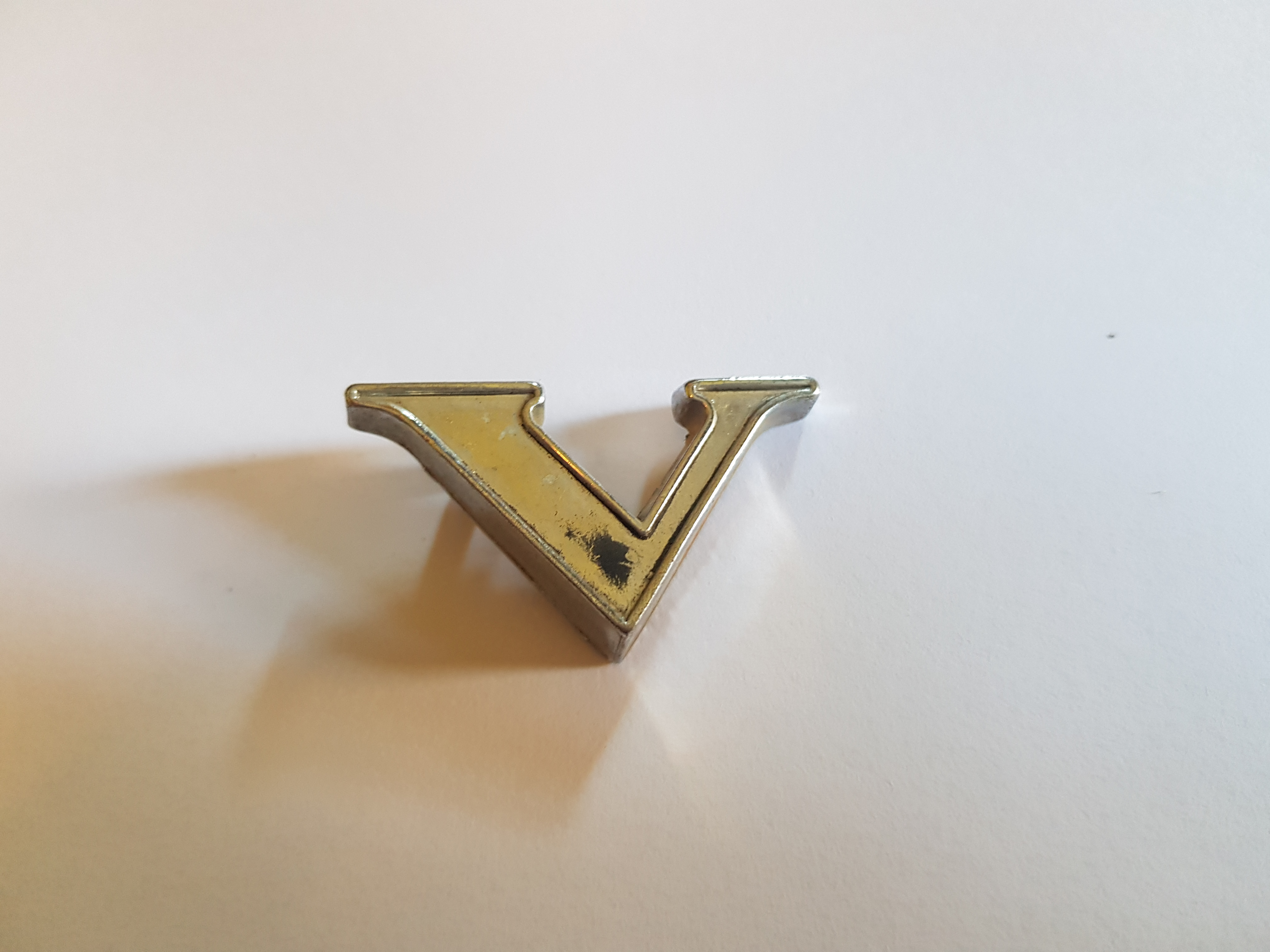 'V' Boot Letter Badge, Salvaged