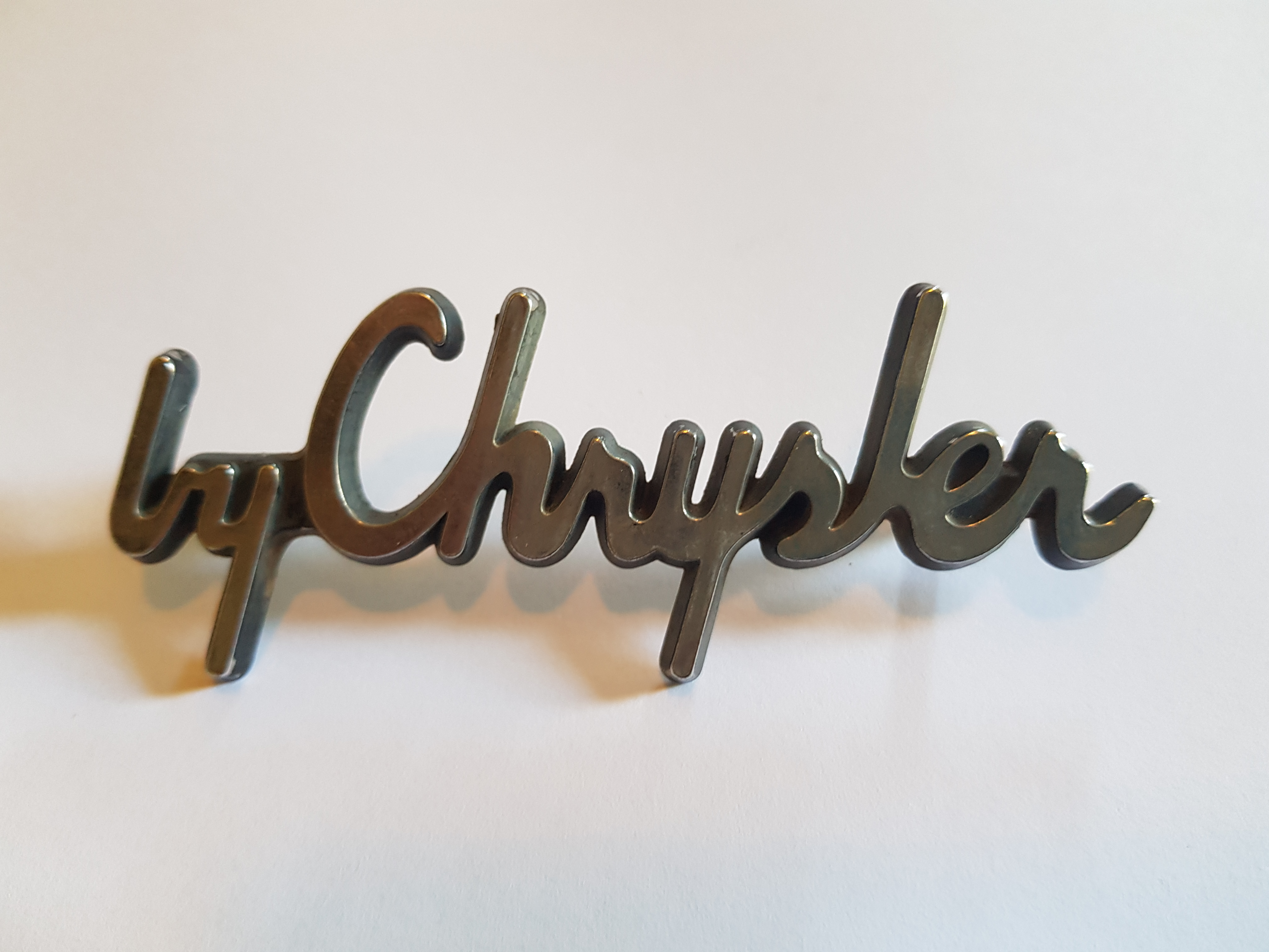 'by Chrysler' Script Badge, salvaged
